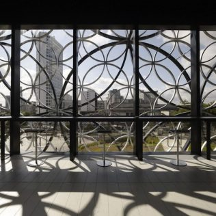 Mecanoo: Metal Patterns On Glass Envelope
